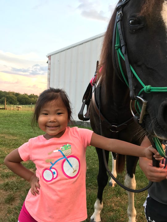 Olive enjoys the family horse in August, eight months after she received a liver in transplant surgery at Cincinnati Children's Hospital Medical Center.