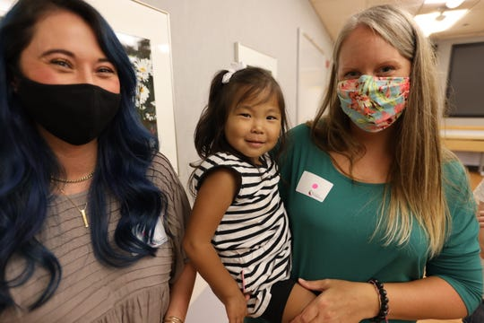 Olive and her mom, Angie Sommers, meet Olive's liver donor, (left) Amanda Powell, on Aug. 25 at Cincinnati Children's Hospital Medical Center.