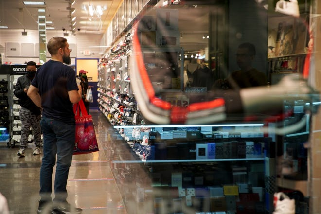 Customers shop for shoes at Governor's Square Mall in Clarksville, Tenn.
