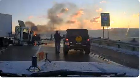 Frame grab from a video of an MSP trooper saving a man from a burning car on on Ann Arbor Road over Interstate 275 in Wayne County Tuesday, Nov. 17, 2020