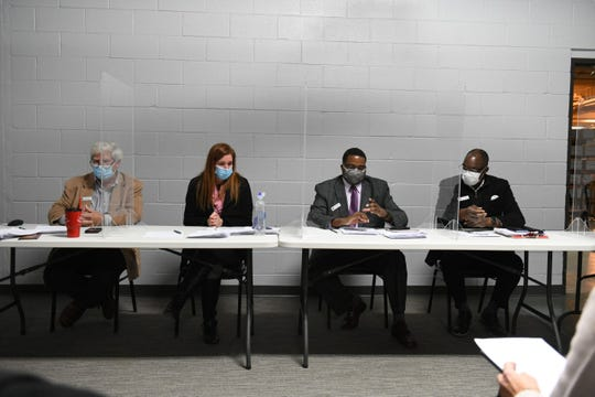 Left: Member William Hartman (Representative), Chair Monica Palmer (Representative) listens to Vice-President Jonathan Kinlock (Democrat) read the proposal to certify the vote with Member Alan Wilson (Democrat) during the Wayne County Governing Council on the road in Detroit on November 17, 2020.