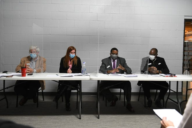 From left: Member William Hartmann (Rep.), chair person Monica Palmer (Rep.) listen as vice chair Jonathan Kinloch (Dem.) reads the motion to certify the vote with member Allen Wilson (Dem.) during the Wayne County Board of Canvassers meet in Detroit on Nov. 17, 2020.
