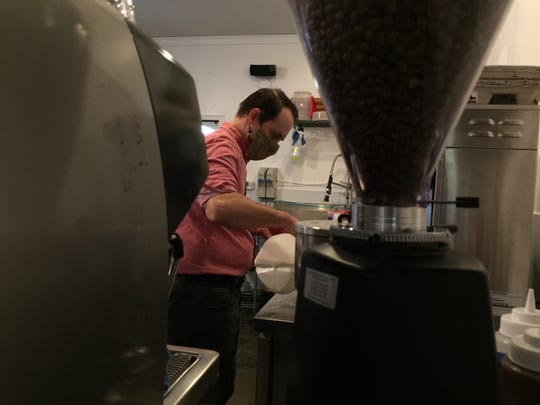 Owner-barista Mitchell Tellstrom prepares an order at Rabble Coffee.