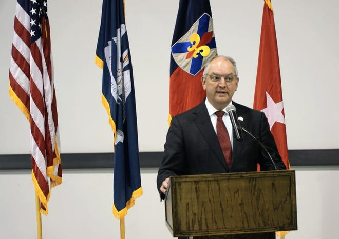 Gov. John Bel Edwards praises the state's service members during a departure ceremony for the Louisiana National Guard's 156th Infantry 'Tiger' Brigade in Lafayette on Wednesday, Nov. 11, 2020.