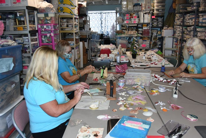 Shell club members craft pieces in their workshop. The Marco Island Shell Club will hold their annual pre-Christmas sale on Friday, Nov. 27 and Friday, Dec. 4, outdoors at St. Mark's Episcopal Church.