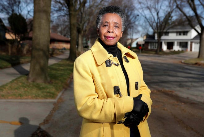 Lennie Mosley stands outside her home, right, on North 5th Street in the Halyard Park neighborhood in Milwaukee. Mosley, who has lived in Halyard Park since 1980 and is president of the Halyard Park Neighborhood Association, thinks development is good, but she is worried about its effect on property taxes.