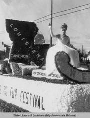 Fur and Wildlife Festival Queen in Cameron, Louisiana, waves to onlookers in the 1960s.