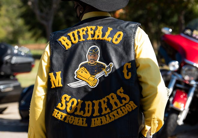 "The back of the vest of a Buffalo Soldiers Motorcycle Club member displays founder Kenneth ""Dream Maker"" Thomas as its centerman patch."