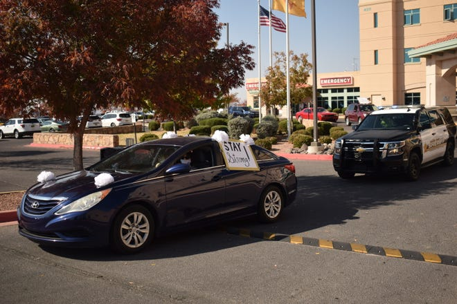A caravan drives through the MountainView Regional Medical Center parking lot to recognize the work of healthcare workers during the COVID-19 pandemic on Wednesday, Nov. 18, 2020.