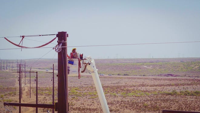 A power line under construction by Xcel Energy in the Permian Basin area.