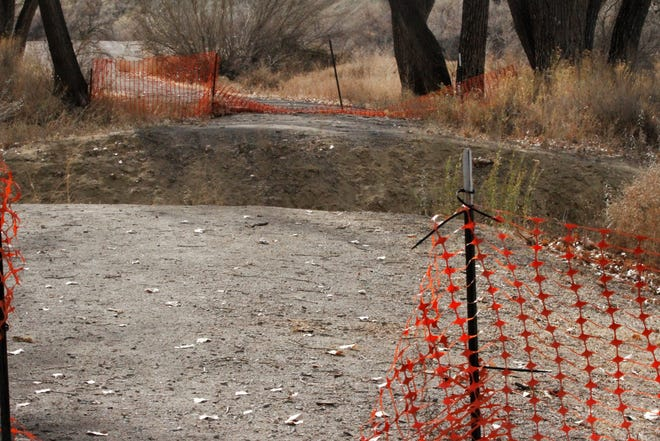 A washed out area where a bridge will be installed is pictured, Wednesday, Nov. 18, 2020, on a portion of the Among the Waters trail in Farmington. The City Council approved a contract to complete the Among the Waters trail, which will connect the confluence of the Animas and San Juan rivers with Boyd Park.