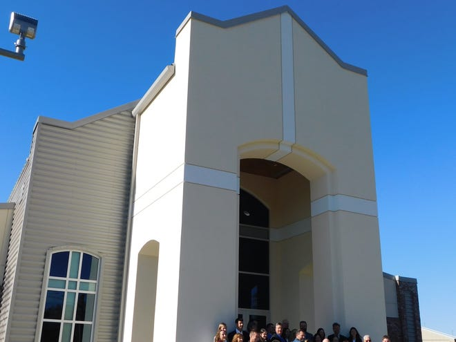 Westminster Christian Academy faculty, administrators and board members line up in front of the school's new on-campus chapel for the official dedication and ribbon cutting Wednesday, Nov. 18, 2020. The $1.9 million chapel and performance center will provide access for student religious services and campus events.