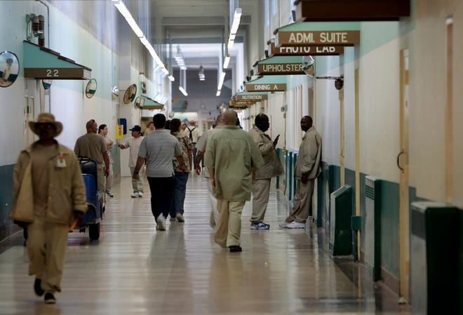 Patients at the Central Coast's Atascadero State Hospital walk the halls in 2006. Due to COVID-19, patients have at times been confined to their units, but still mingle in bathrooms, the dining hall and common day rooms. Of the state's psychiatric hospitals, Atascadero houses the largest number of mentally ill inmates from state prisons.
