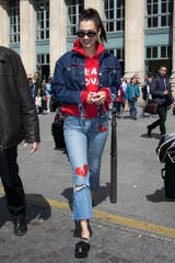 Bella Hadid wearing jeans and a hoodie from Phoenix designer Amanda Litzinger's Stickybaby collection in 2017.