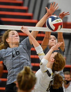 York Suburban's Maddison Perring, left, and Eliana Rodgers block a tap-over by Emma Maskiell of Bethlehem Catholic during the PIAA Class 3-A girls' volleyball state semifinal game, Tuesday, November 17, 2020 John A. Pavoncello photo