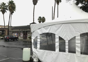 A tent for outdoor dining sits outside Marie Callender's restaurant on Tuesday, Nov. 17, 2020.
