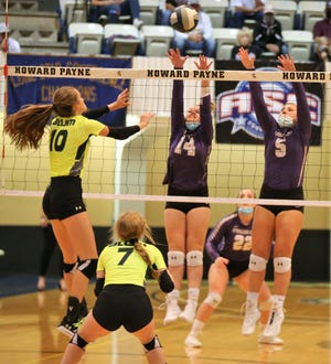 Sterling City High School's Kinzee Woods, 14, and Brooklyn Gaines try to block a kill attempt by Blum's Emma Jones during a Class 1A state volleyball semifinal at Howard Payne University in Brownwood on Tuesday, Nov. 17, 2020.