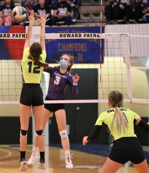 Sterling City's Kate Barnes makes an attack as Blum's Gracie Allen defends the net during a Class 1A state volleyball semifinal at Howard Payne University in Brownwood on Tuesday, Nov. 17, 2020.