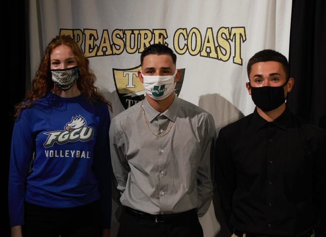 Shelby Kent, left, Justyn Ros and Jaden Paradoa signed letters of intent for college on Wednesday, Nov. 18. Kent will play volleyball at Florida Gulf Coast University, Ros will play baseball at University of South Carolina Upstate and Paradoa will play baseball at Palm Beach State College.