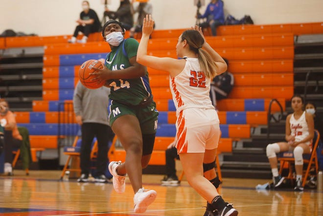 Montwood's Ruth Sodipe goes against Canutillo's Jacquelyn Terrazas during the game Tuesday, Nov. 17, at Canutillo High School in El Paso.