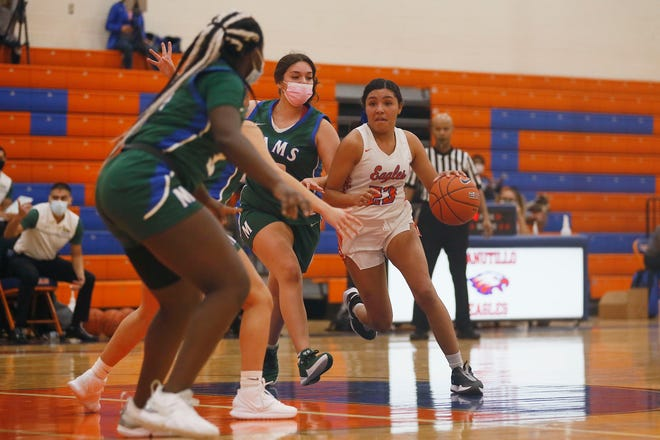Canutillo's WastŽ Little Spotted Horse goes against Montwood defense during the game Tuesday, Nov. 17, at Canutillo High School in El Paso.