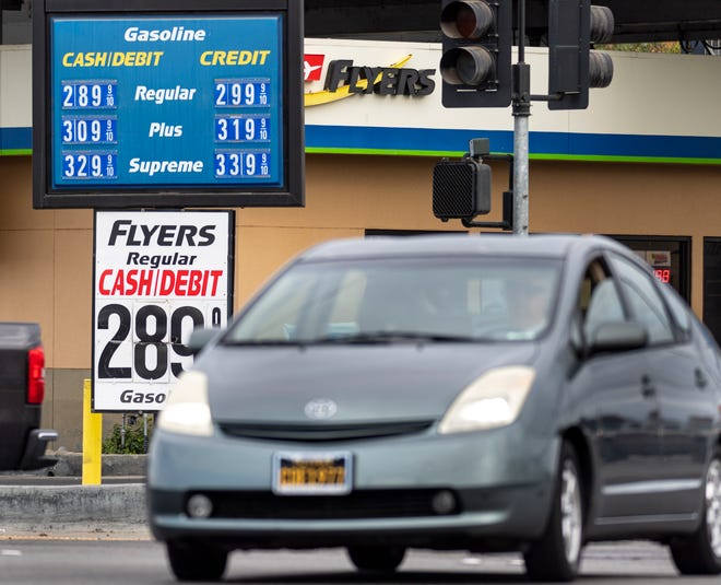 Motorist pass Flyers gas station at Mooney Boulevard and Walnut Avenue on Wednesday, November 18, 2020.