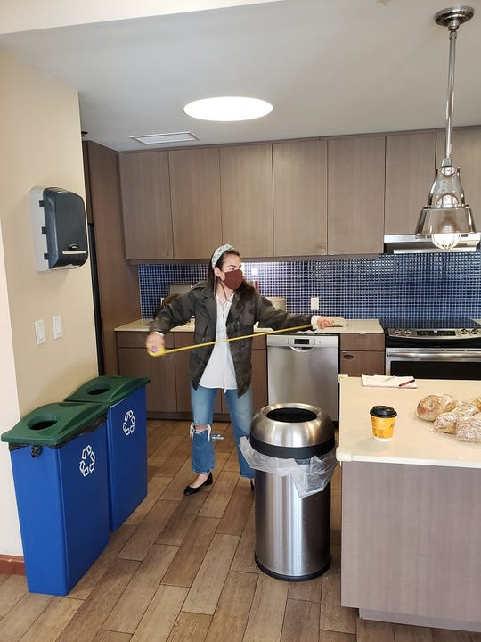 The team at One Room Wonders measures the kitchen at Ronald McDonald House in Valhalla.