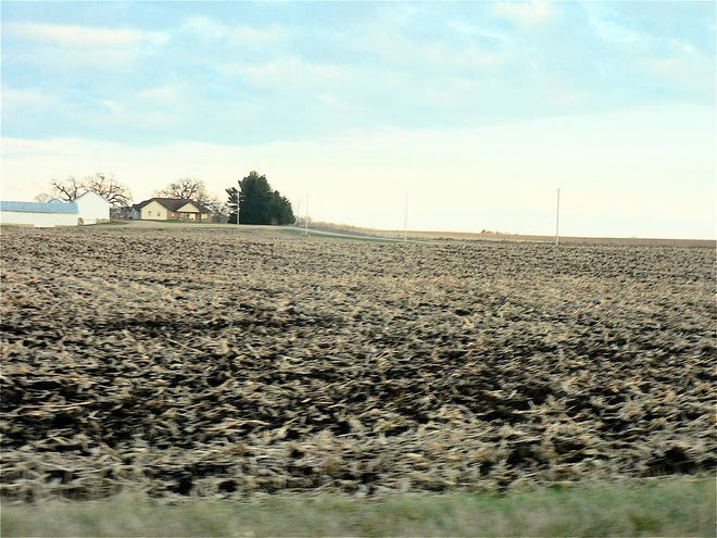 The farm field lay empty of crops with many acres already tilled for the coming winter.