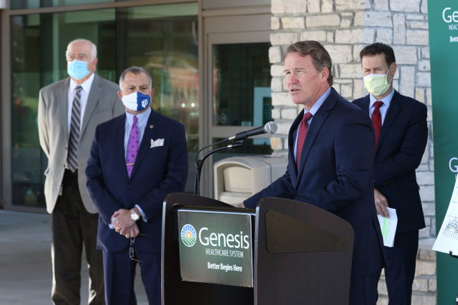 Ohio Lt. Governor Jon Husted speaks outside Genesis Hospital on Wednesday. Husted urges Ohioians to continue to take precautions against COVID-19. Listening behind him are Dr. Jack Butterfield of the Zanesville-Muskingum County Health Department, left, Zanesville Mayor Don Mason, and Genesis HealthCare System CEO Matthew Perry.