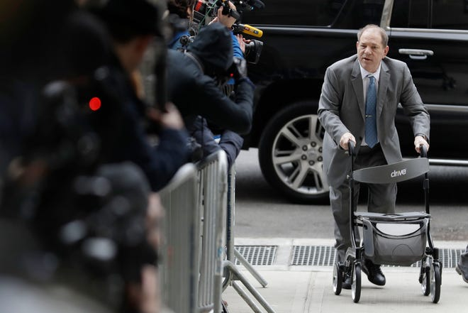 Harvey Weinstein talks to reporters as he arrives at a Manhattan courthouse for his rape trial in New York, Tuesday, Feb. 18, 2020.