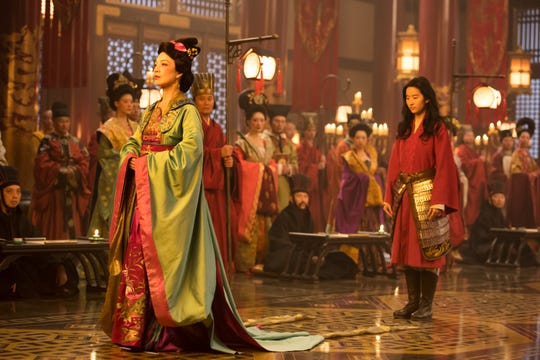 """Ming-Na Wen (the voice of Mulan in the 1998 animated Disney film) introduces Mulan (Yifei Liu) in the live-action """"Mulan."""" Shooting the scene was a top secret mission."""