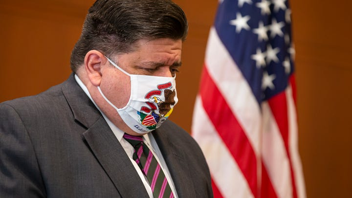 In this Sept. 21, 2020 file photo, Illinois Governor JB Pritzker appears at a news conference in Springfield, Ill. Voters have rejected a proposal to abolish Illinois' flat-rate income tax for one that would take a greater share from wealthier taxpayers.The outcome of Tuesday's Nov. 3, vote handed Pritzker the first major defeat of his 22-month tenure.