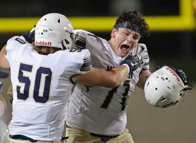 Hoban lineman Drew Pasadyn, right, celebrates with Grant Gainer after defeating St. Edward 35-0 in September.