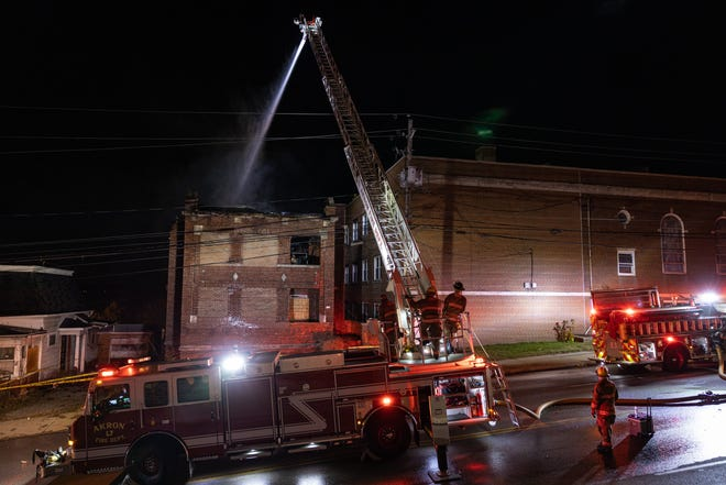 Akron firefighters battling a blaze in an apartment building on Perkins Avenue.