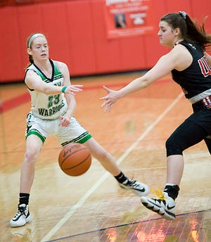 West Branch's Anna Lippiatt passes in a girls Division II district semifinal game against Salem in February 2020. Lippiatt is the Warriors' lone returning starter.