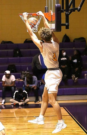 Anacoco's Brayden Blakeway (4) throws down a two-handed slam during the Indians' win over Avoyelles Charter on Tuesday. Blakeway scored 17 points, being one of four Anacoco players in double figures.