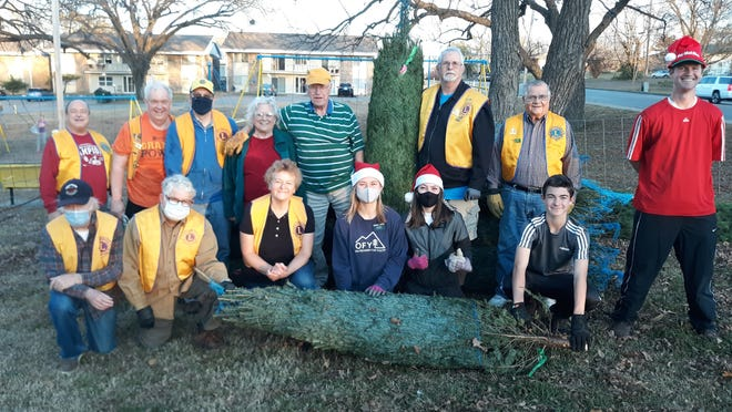 Bartlesville Lions Club members and some helpers were on hand to unload Christmas trees. Back row, from left, Wayne Middleton, Denny McBroom, Wayne Benyshek, Dollie and David Wooddell, Dave Whitaker, C.A. Mathiesen. Front row, from left, Norm Lavoie, Jim Grillot, Debbie Reid, Hermana Valentine, Hermana Pettit, Austin Bastings, and Craig Bastings.