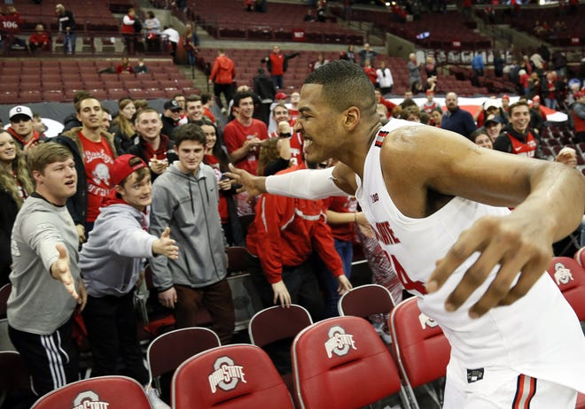 Ohio State Buckeyes forward Kaleb Wesson (34) high fives students following the NCAA men's basketball game against the Indiana Hoosiers at Value City Arena in Columbus on Saturday, Feb. 1, 2020. Ohio State won 68-59. [Adam Cairns/Columbus Dispatch]
