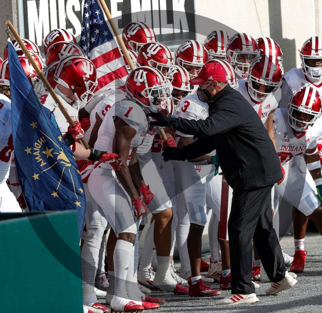 In this file photo, Coach Tom Allen fires up his Indiana players before they run onto the field for a game against Michigan State on Saturday.