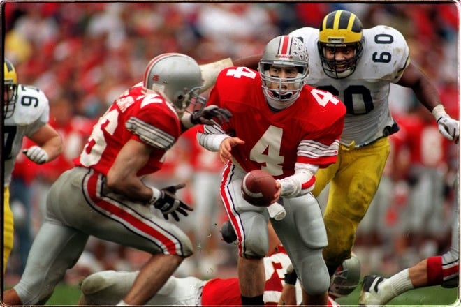 Ohio State senior quarterback Kirk Herbstreit (4) had a career day passing against Michigan in 1992 but it still wasn't enough to bag a win against the Wolverines.