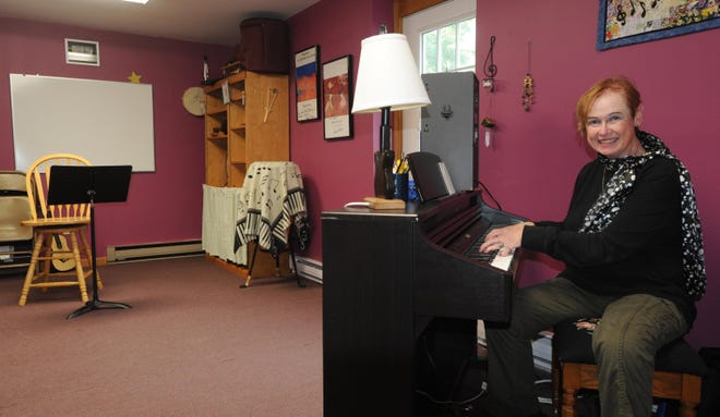"Norma Atwood, owner of Village Music in South Yarmouth, has kept her business afloat by blending online lessons with in-person instruction. ""I am a very positive person,"" she says. ""I just have to keep going. Right now it is very tough for small businesses."""