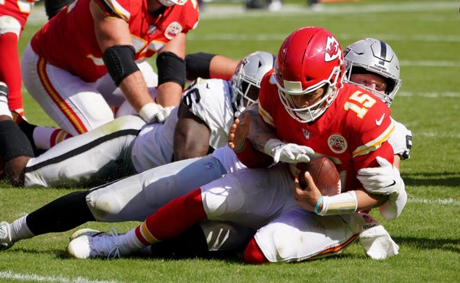 Kansas City Chiefs quarterback Patrick Mahomes (15) is sacked by Las Vegas Raiders defensive end Maxx Crosby (98) during a game Oct. 11 at Arrowhead Stadium in Kansas City.