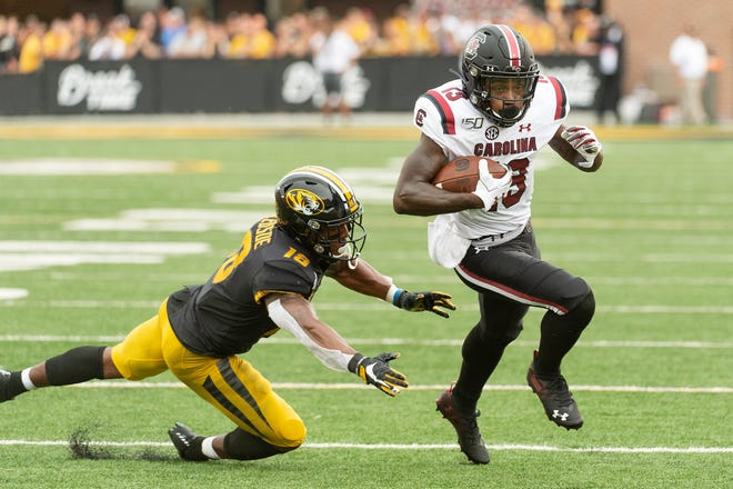 South Carolina wide receiver Shi Smith, right, runs past Missouri safety Joshuah Bledsoe, left, during a Southeastern Conference game Sept. 21, 2019, at Faurot Field.