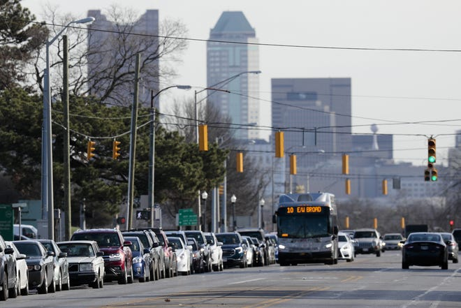 Cars line up along West Broad Street as they wait at a COVID-19 testing site on Thursday, Nov. 19, 2020 at PrimaryOne Health in Columbus, Ohio. The testing site, a pop-up site staffed by medics from the Ohio National Guard and PrimaryOne Health employees, had lines that stretched for a half-mile from the testing site, with wait times for patients up to two hours or more.