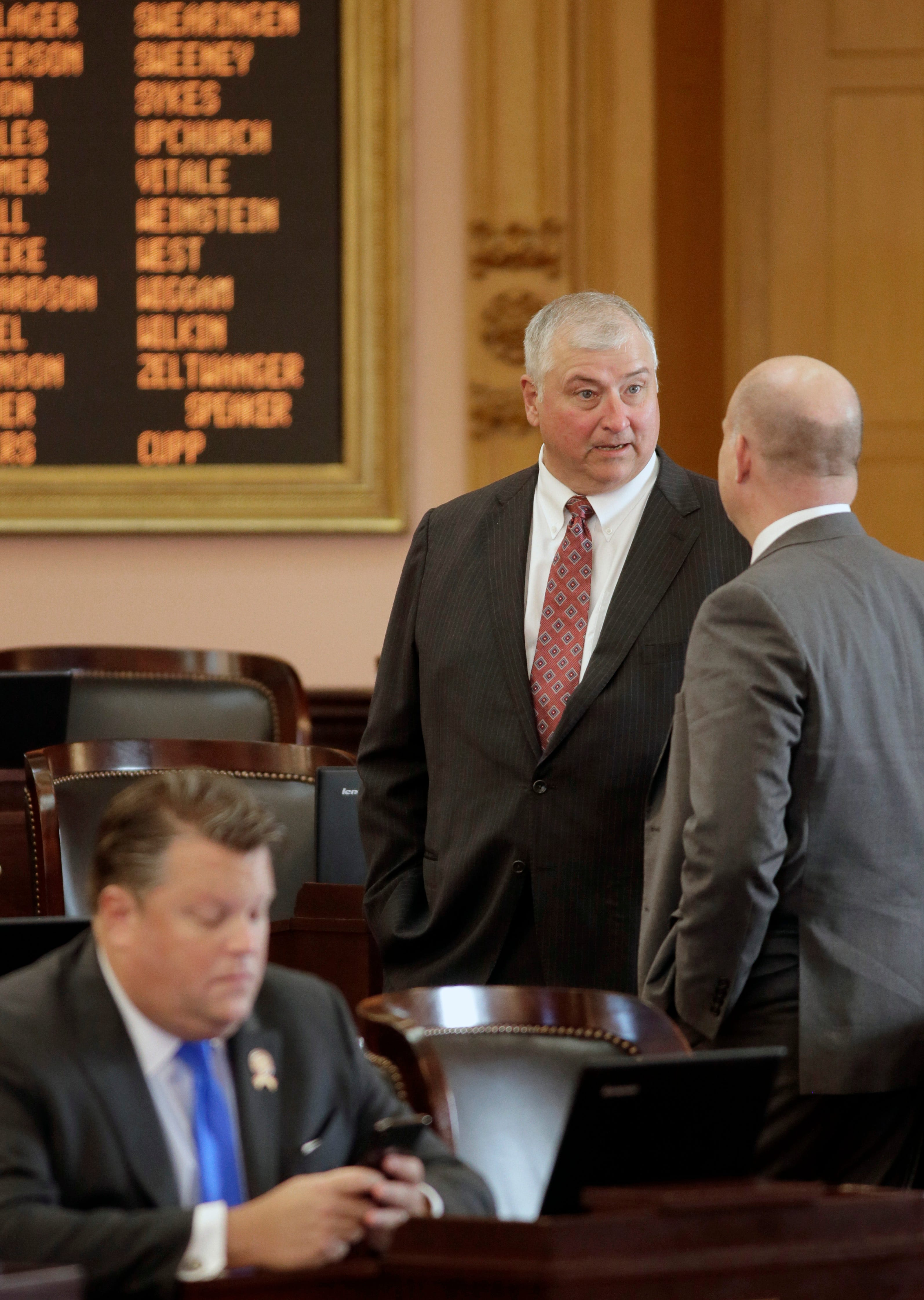 State Representative Larry Householder (Rep.) speaks with another member inside the House Chambers at the Ohio Statehouse before a session began on Wednesday, November 18, 2020.