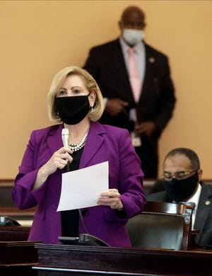 Ohio Senator Teresa Fedor speaks while wearing a mask during a session at the Ohio Statehouse on Wednesday, November 18, 2020.