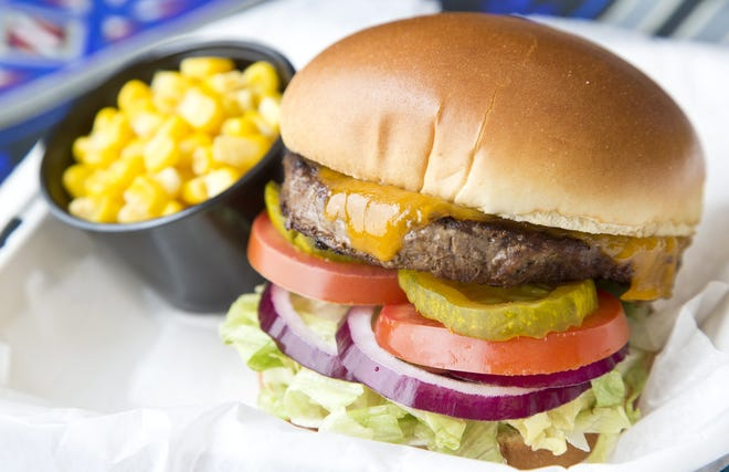 Buffalo cheeseburger with a side of corn from NAICCO Cuisine