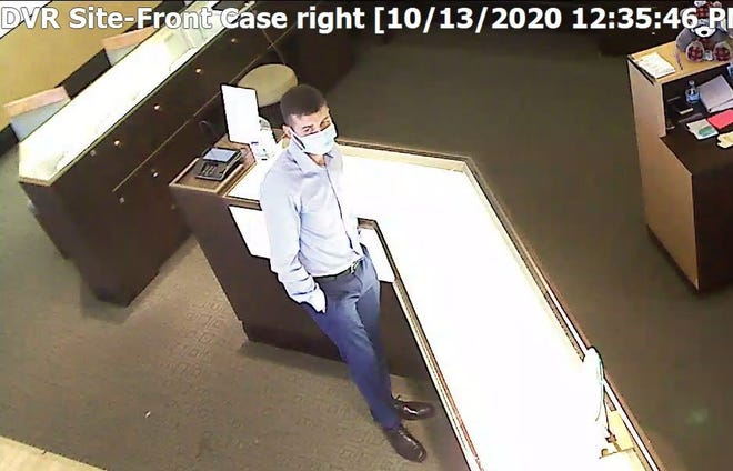 This man, believed to have been involved in credit card thefts across the country, stole credit cards from a gym locker room in October. He then used them to rack up thousands of dollars in purchases. Information leading to his arrest could result in a cash reward.