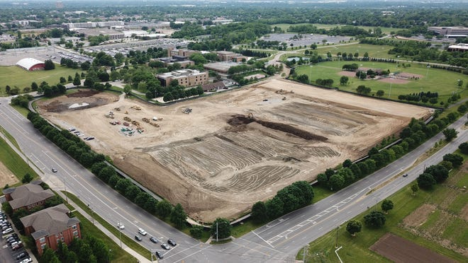 In this June 16, 2020 photo, the athletic fields once at Lane Avenue and Kenny Road have made way for Ohio State's Energy Advancement and Innovation Center and an interdisciplinary research facility.