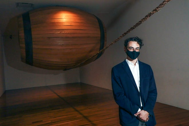 """Tyler Cann, head of exhibitions andPizzuti Family Curator of Contemporary Art, with """"Spirit"""" (1994) by Mel Chin."""